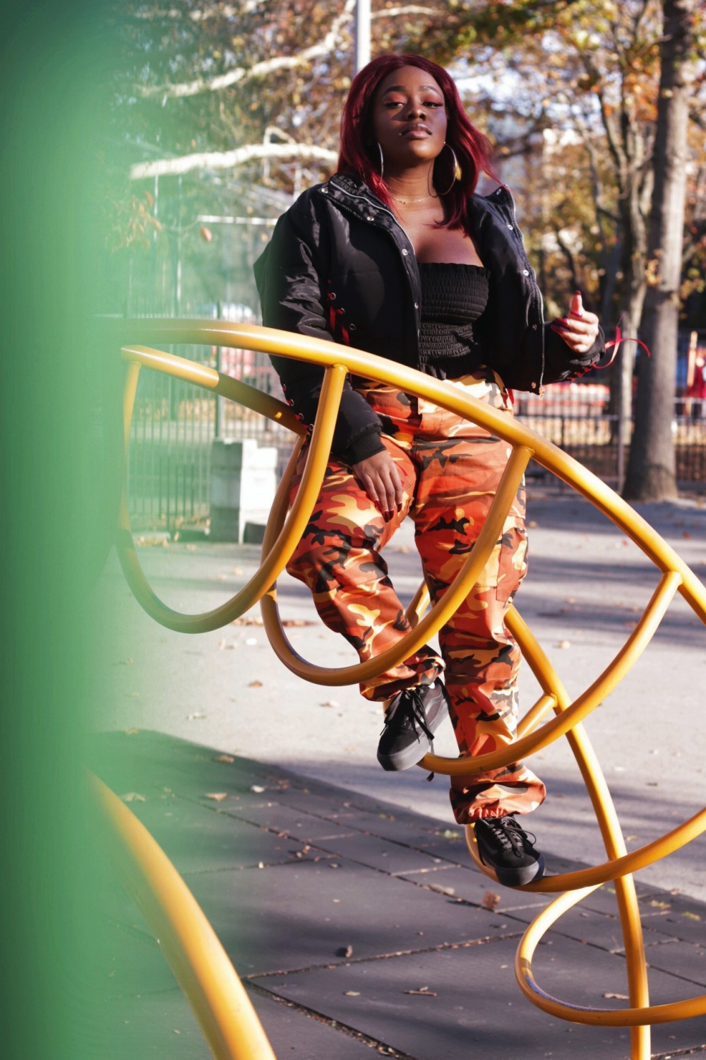 cropped bomber - bandeau - red hair - cargo pants - vans - fall - fashion - playground